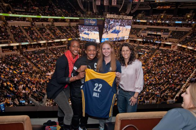 Lauren Hill with Fever Coach Stephanie White and Players Tamika Catchings and Shavonte Zellous