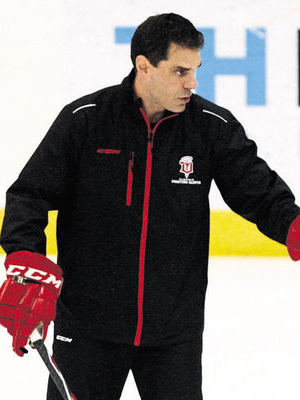 Dubuque Fighting Saints Head Coach Jason Lammers in Action