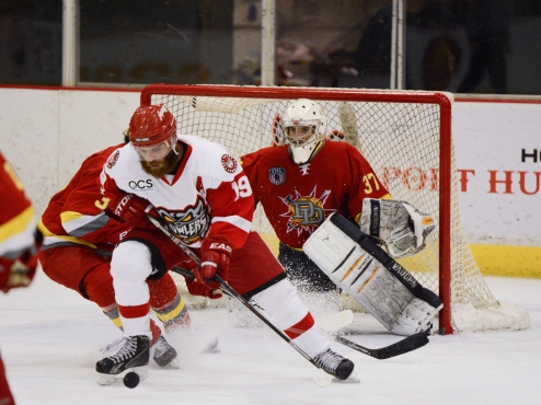 Port Huron Prowlers Control the Puck in Front of the Dayton Demolition Goal