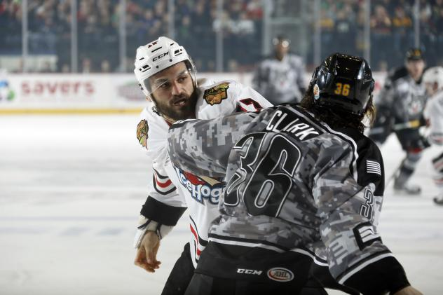 Chicago Wolves LW Emerson Clark vs. Michael Liambas of the Rockford IceHogs