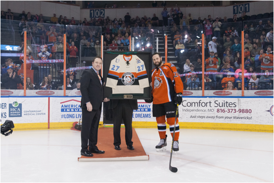 Brent Thiessen Presents Andrew Courtney of the Missouri Mavericks with a Commemorative Jersey