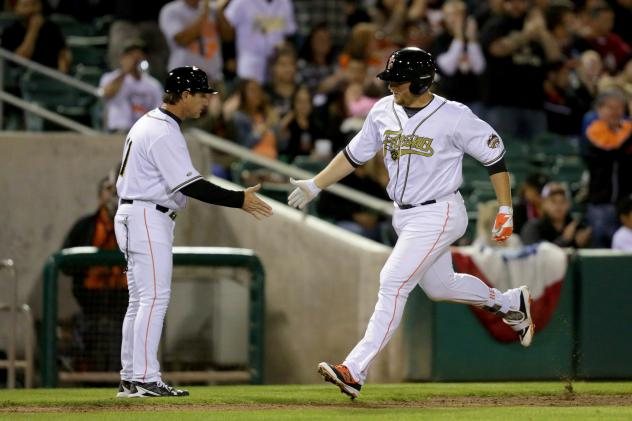 A.J. Reed of the Fresno Grizzlies Crosses the Plate