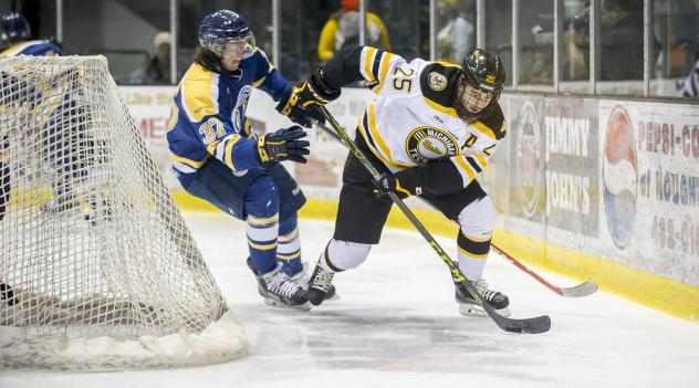 Forward Michael Neville with Michigan Tech