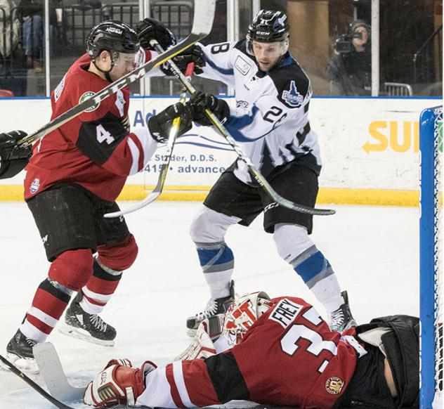 Idaho Steelheads fight for the puck in front of the Rapid City Rush net
