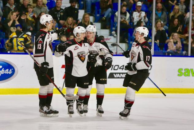Ty Ronning and Vancouver Giants offer congratulations after a goal
