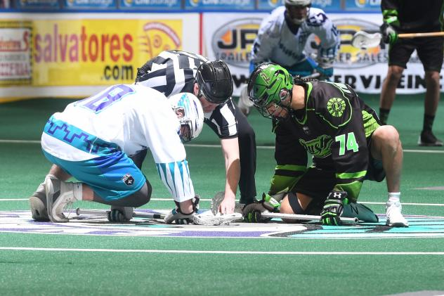 Jake Withers of the Rochester Knighthawks and the Saskatchewan Rush faceoff