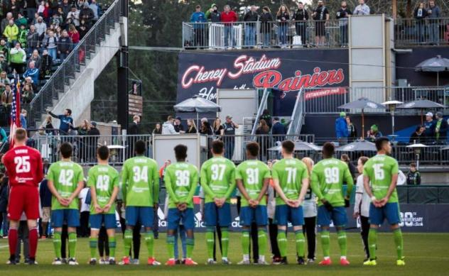 S2 players standing for the anthem before last Friday's inaugural match at Cheney Stadium