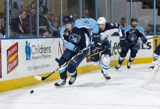 Jack Dougherty of the Milwaukee Admirals corrals the puck vs. the Manitoba Moose