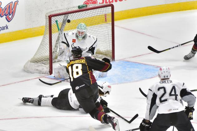 Ryan Kujawinski of the Cleveland Monsters scores against the San Antonio Rampage