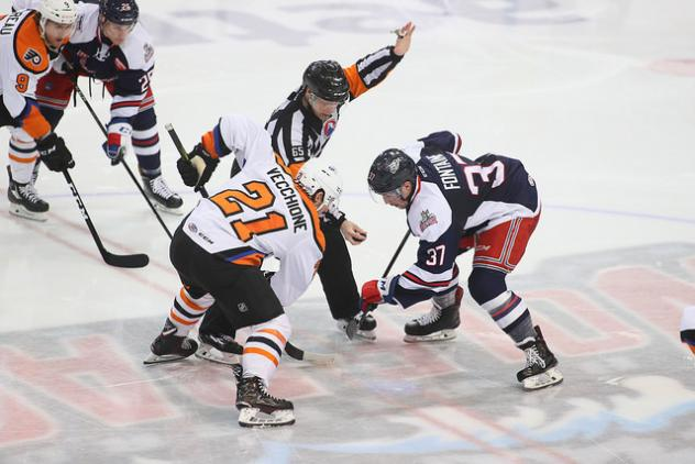 Lehigh Valley Phantoms Forward Mike Vecchione faces off against the Hartford Wolf Pack