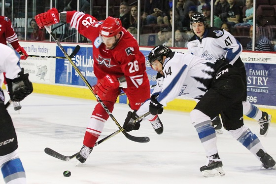 Spencer Asuchak of the Allen Americans vies for the puck vs. the Idaho Steelheads