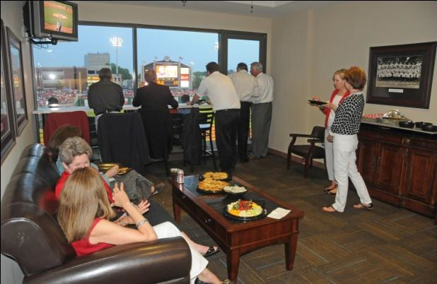 Fans enjoying an Arkansas Travelers game from a suite