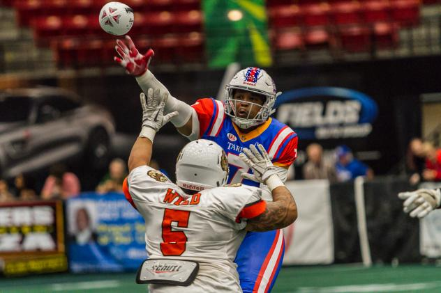 Florida Tarpons quarterback Chris Wallace gets off a pass against Austin Wild pressure