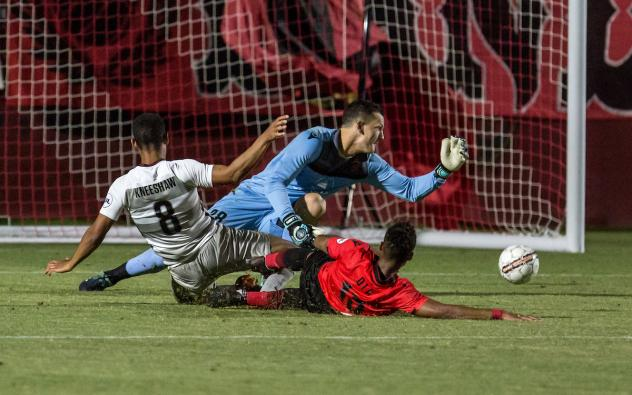 Sacramento Republic and Phoenix Rising FC pileup in front of the net
