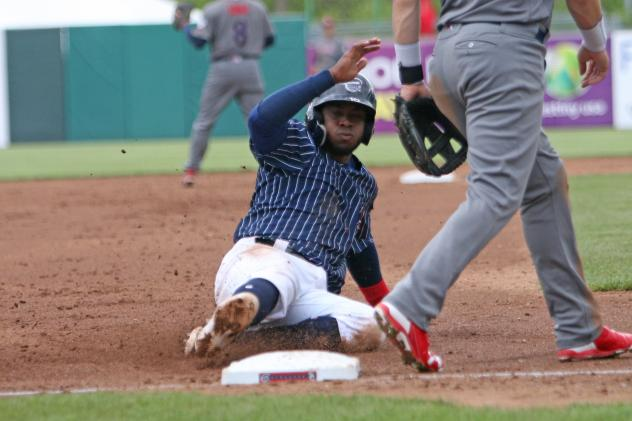 Irving Falu of the Syracuse Chiefs slides safely into third