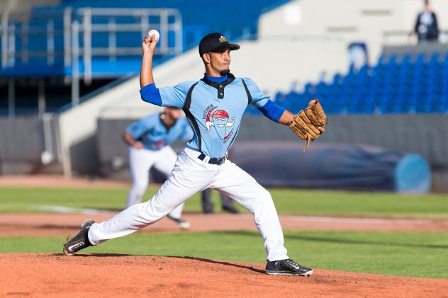 Victoria HarbourCats pitcher Adriel Queseda Pena delivers the first pitch