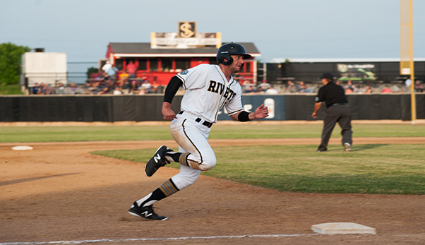 Parker Bates of the Rockford Rivets heads to third with an eye on home