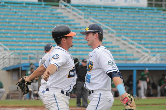 Kalamazoo Growlers celebrate with a chest bump