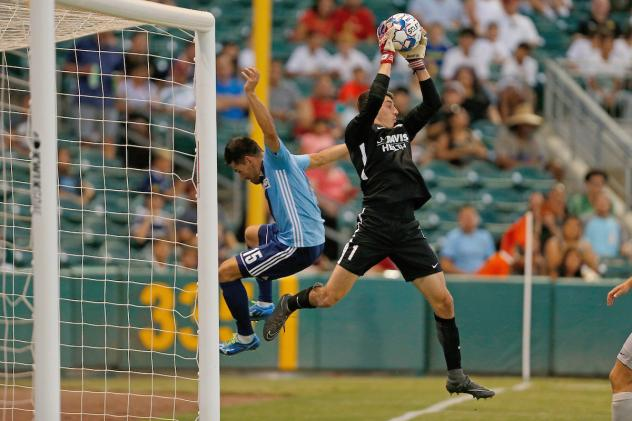 Sacramento Republic FC goalkeeper Josh Cohen makes a save vs. Fresno FC