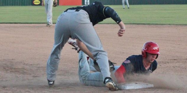 A close play for the Acadiana Cane Cutters