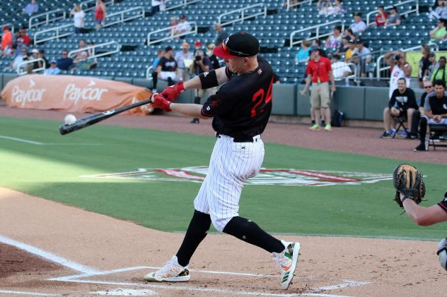 Zack Collins of the Birmingham Barons blasts a homer in the Southern League Home Run Derby