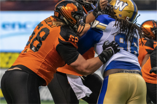 David Foucault of the B.C. Lions protects against the Winnipeg Blue Bombers rush
