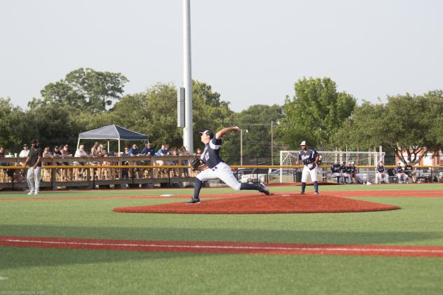 Brazos Valley Bombers deliver a pitch