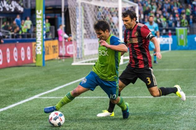 Seattle Sounders FC's Nico Lodeiro and Atlanta United's Michael Parkhurst face off