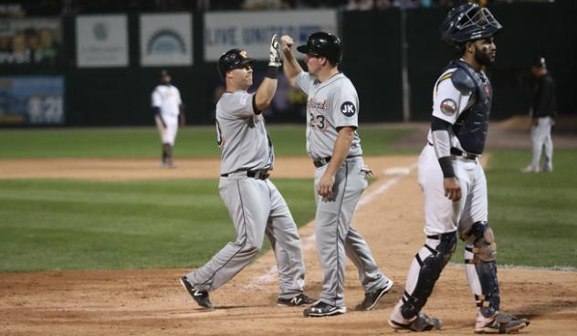 Lew Ford and Travis Snider of the Long Island Ducks exchange high fives
