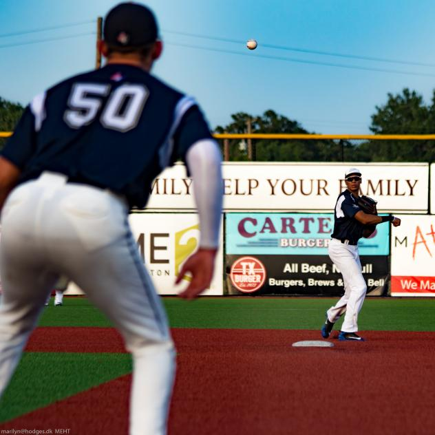 Brazos Valley Bombers throw to first