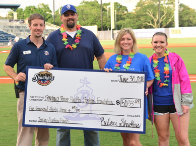 Biloxi Shuckers present a check to Singing River Health System Foundation