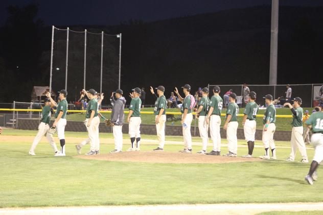 Medford Rogues line up for high fives