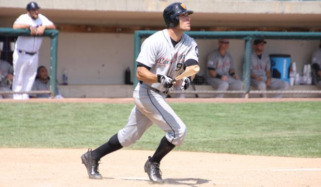 Anthony Vega of the Long Island Ducks watches his home run