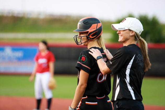 Brenna Moss of the Chicago Bandits receives congratulations on her record-tying hit