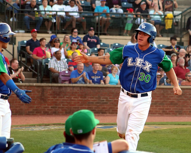 Nick Pratto of the Lexington Legends comes in to score