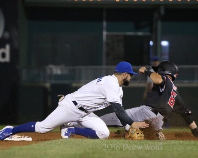 Rylan Sandoval of the Rockland Boulders tags out a New Jersey Jackals player attempting to steal