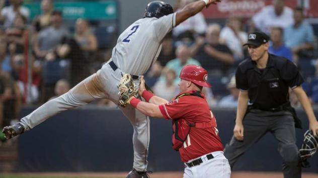 Vancouver Canadians C Brett Wright tags Tri-City Dust Devils 2B Xavier Edwards