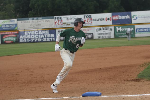 Cole Carder of the Medford Rogues rounds third