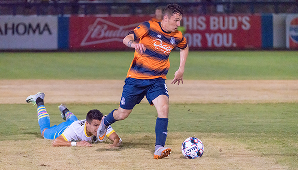Michael Gamble of the Tulsa Roughnecks breaks away with the ball