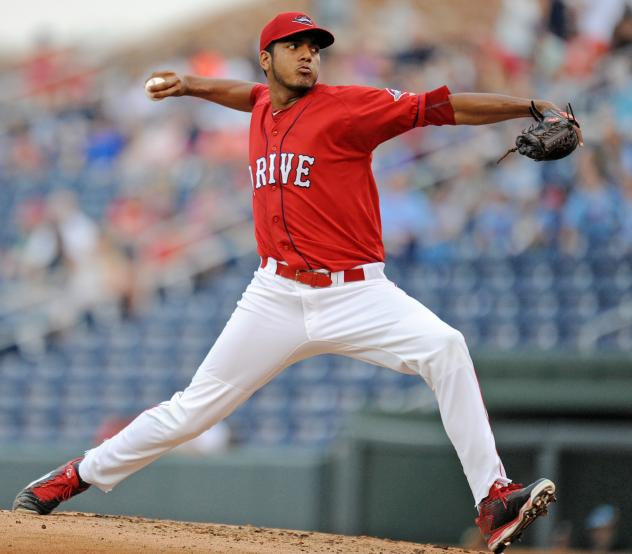 Greenville Drive pitcher Denyi Reyes prepares to throw