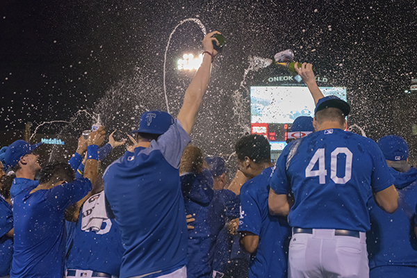 The Tulsa Drillers celebrate after clinching a playoff berth