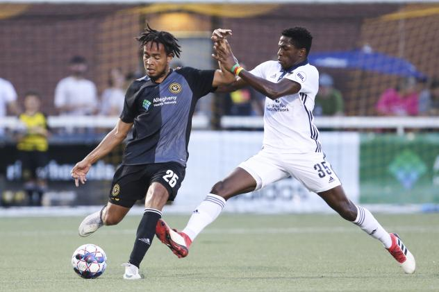 Faris of Bethlehem Steel FC maintains possession against the Pittsburgh Riverhounds