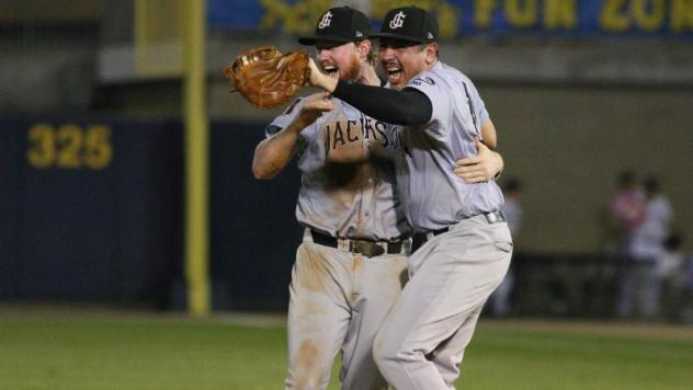 Jackson Generals infielders Marty Herum and Rudy Flores celebrate a Southern League title