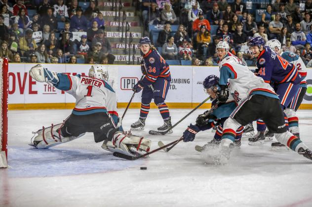 Kelowna Rockets goaltender James Porter scrambles to keep the puck out of the net against the Kamloops Blazers
