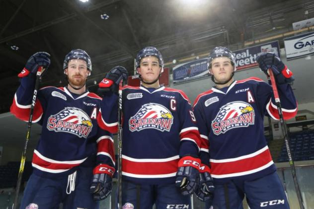 Saginaw Spirit captain Damien Giroux flanked by alternate captains Brady Gilmour and D.J. Busdeker
