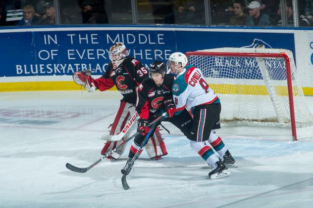 Kelowna Rockets in front of the Prince George Cougars goal