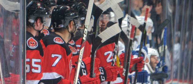 Binghamton Devils bench watches the action