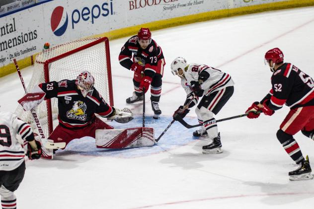 Grand Rapids Griffins goaltender Harri Sateri stretches to make a save against the Rockford IceHogs