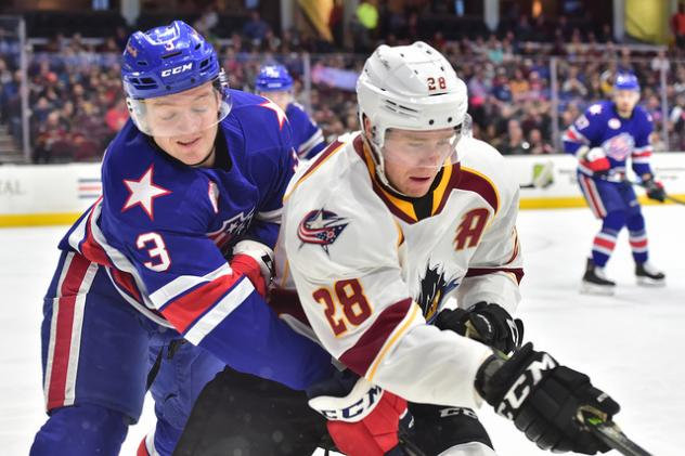 Cleveland Monsters center Zac Dalpe (right) and the Rochester Americans battle