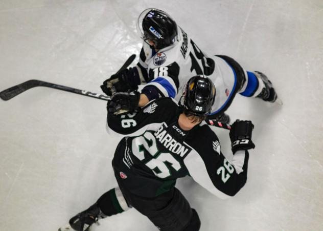 Utah Grizzlies forward Travis Barron tangles with the Wichita Thunder